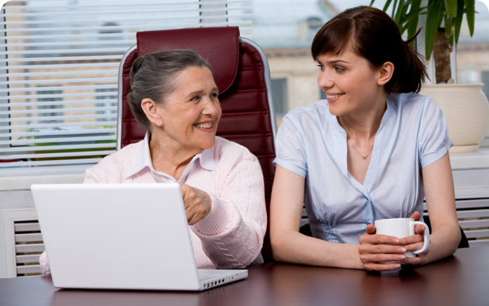 graphicstock-portrait-of-elderly-woman-consulting-her-pretty-granddaughter-what-to-type_H500E0wEb@2x
